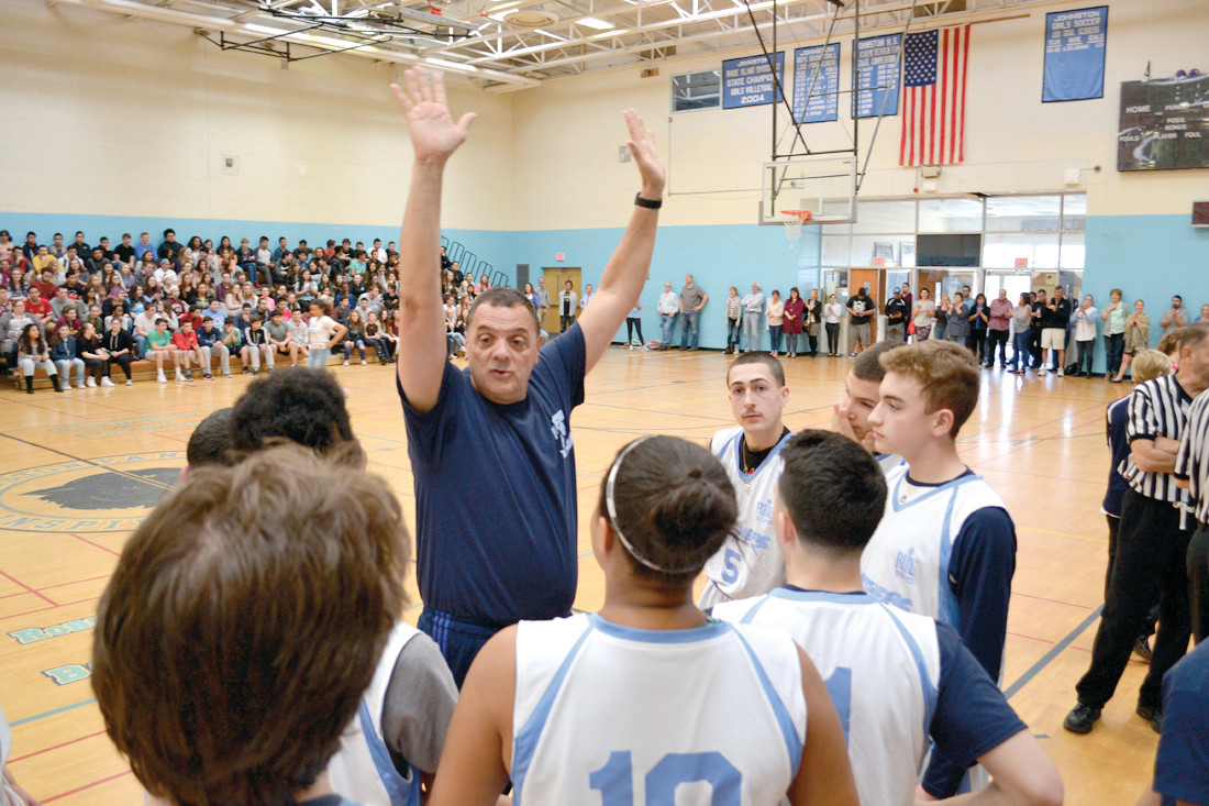 TAKING THE COURT: Johnston coach Dan Mazzulla gives some words of wisdom to his team.