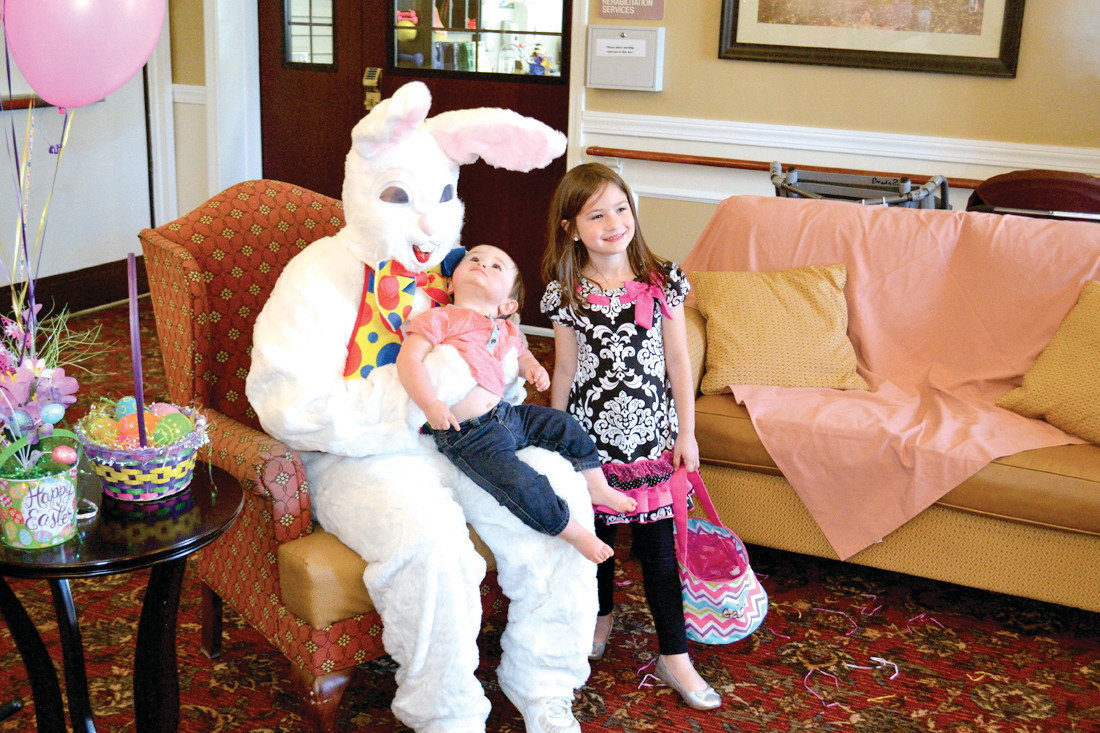 A HOPPING TIME: 1-year-old Michael Larson and his 5-year-old sister, Gabriella, took time to meet with the Easter Bunny.