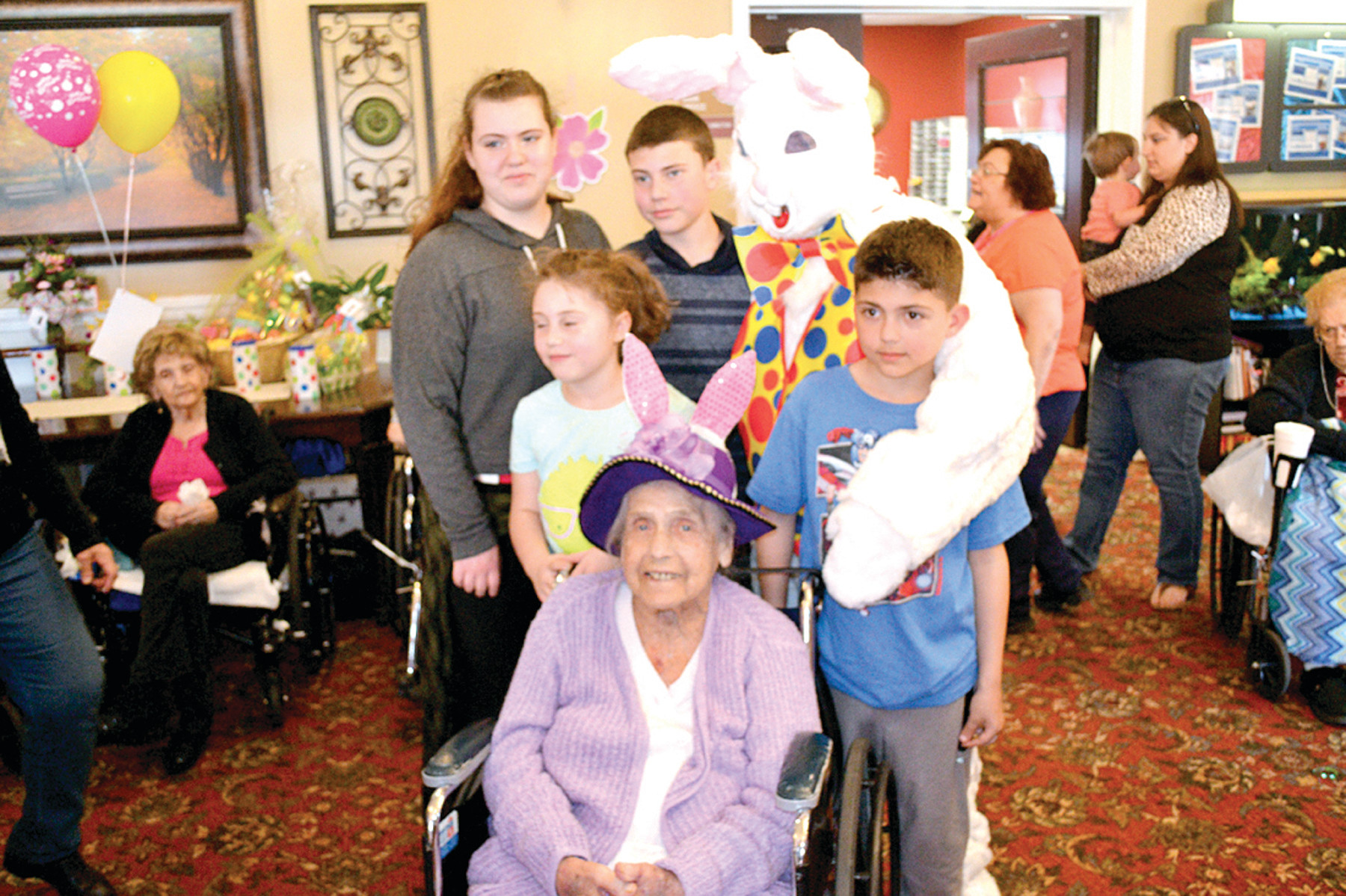 FAMILY CELEBRATION: 98-year-old Regina Parenteau was joined by her family during last Friday's Easter extravaganza at Cherry Hill Manor.