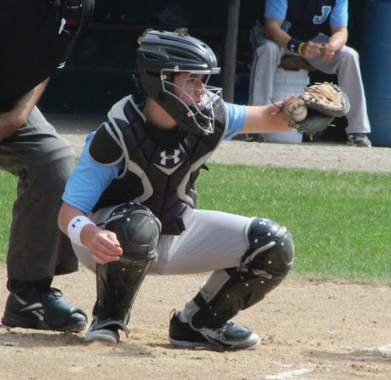 FRAMING: Andrew Clesas receives a pitch behind the plate.
