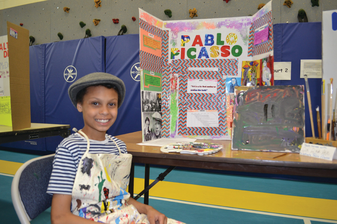 A MASTERPIECE: Evin Paquette chose artist Pablo Picasso for his project. Evin had a canvas for his presentation that visitors could paint on to create a combined work of art.