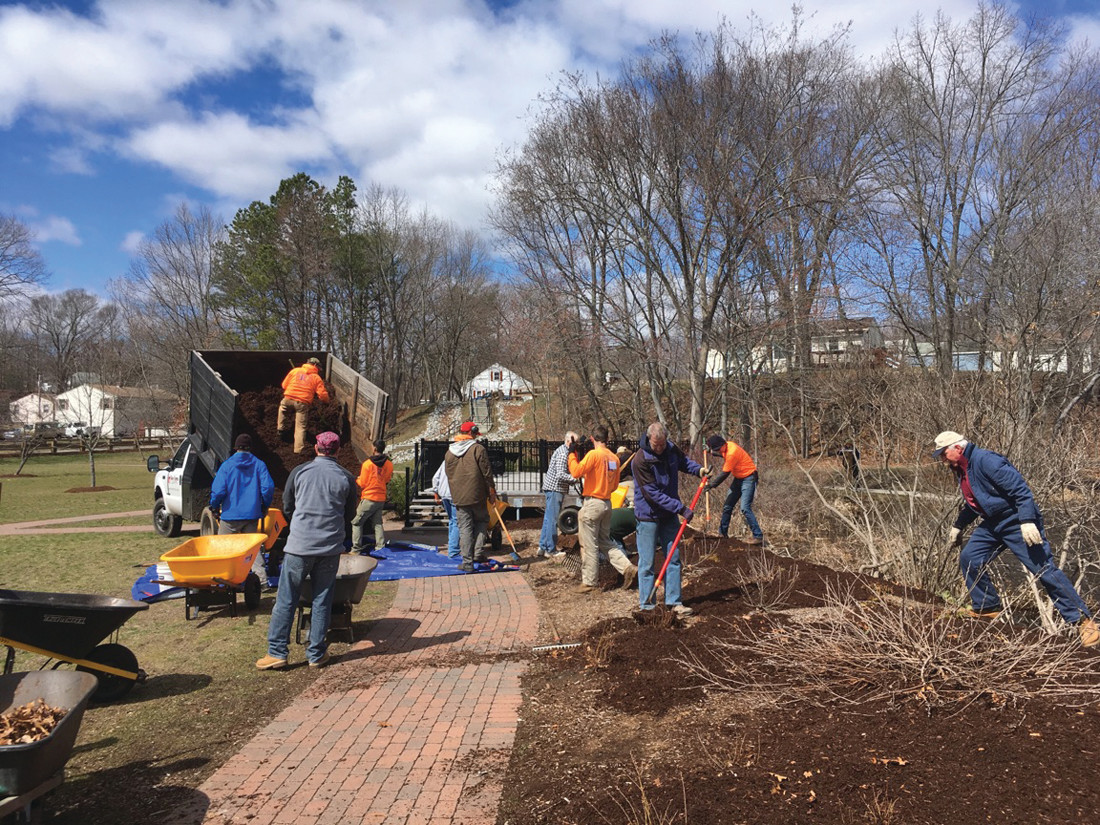 CLEAN-UP CREW: Around two dozen volunteers spent the day cleaning Cricket Field, a multi purpose park that borders Greystone Mill Pond