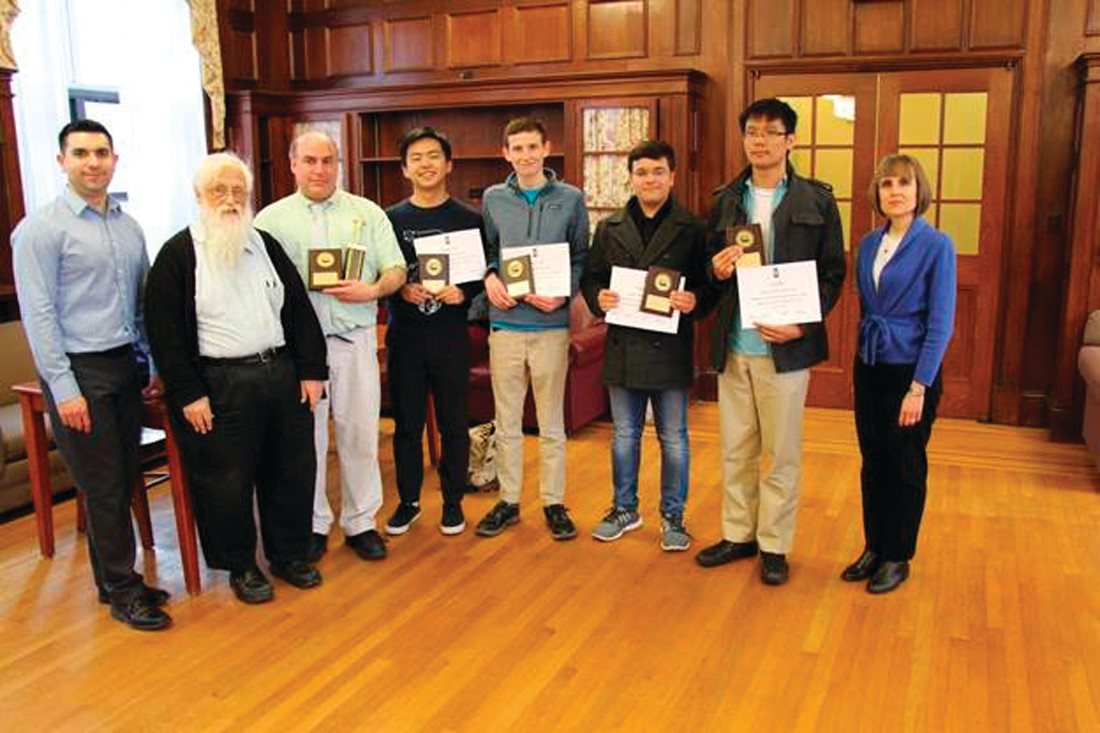 WINNING PROGRAMMERS: The Hendricken team won the 31 annual computer programming competition held at Providence College. Pictured from left are: Dr. Adam Villa, associate professor of computer science at Providence College; Francis Ford, assistant professor of computer science of Providence College; Mark DiPippo, coach; Yuanbo Jiang, junior student; Henry Pratt, senior student; Paarth Tandon, sophomore student; Fred Choi, senior student; Dr. Sheila Liotta, dean of the school of arts and sciences at Providence College.