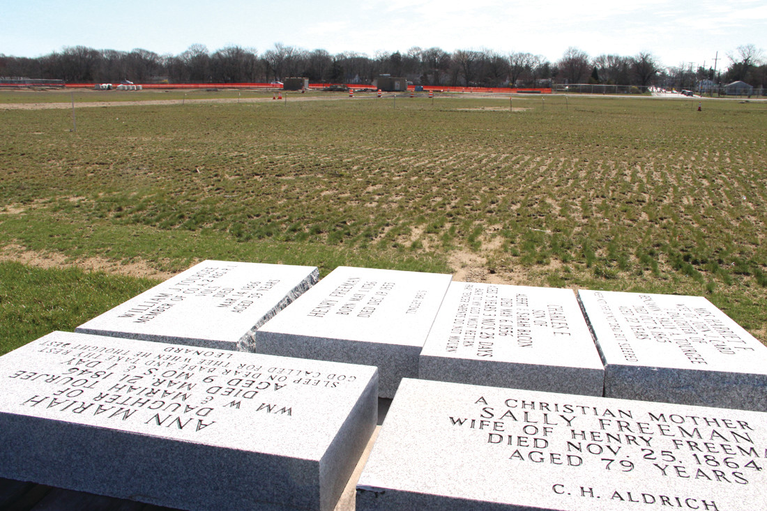 New granite stones that will be flush with the ground will mark the graves near the runway. The original stones have been re-located to a fenced in area off Industrial Drive.
