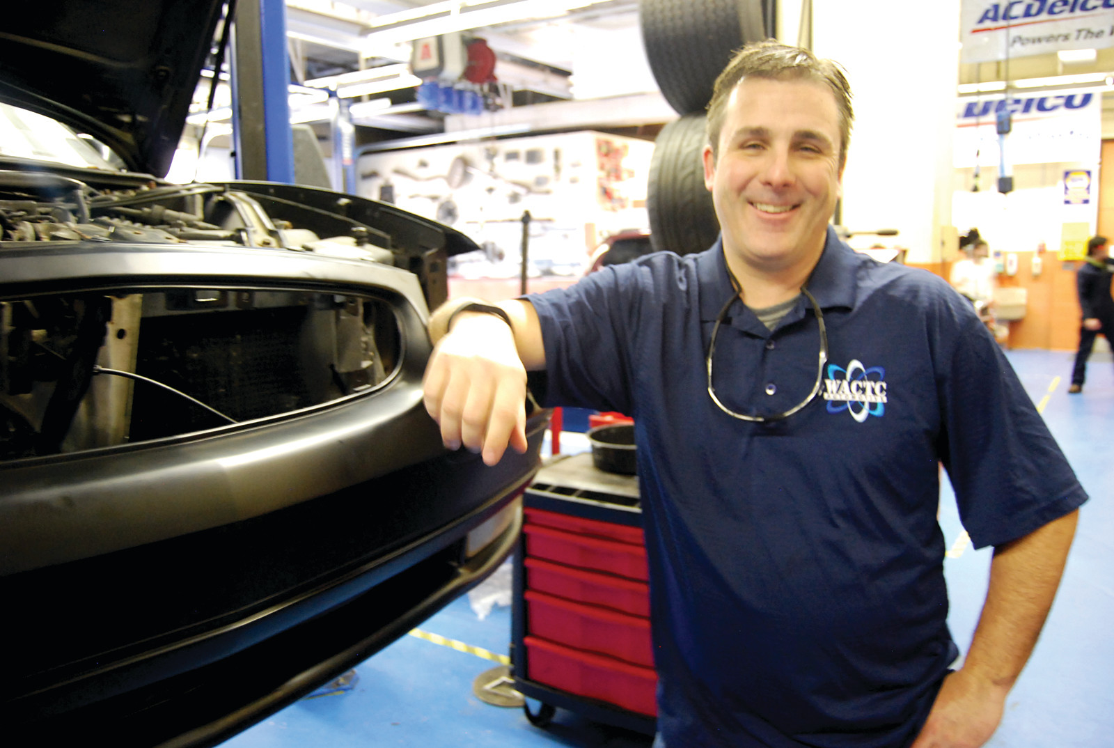 A FUTURE IN CARS: David Tibbetts, instructor at the Warwick Area Career and Technical Center finds the skills taught in the program transferable to many jobs.