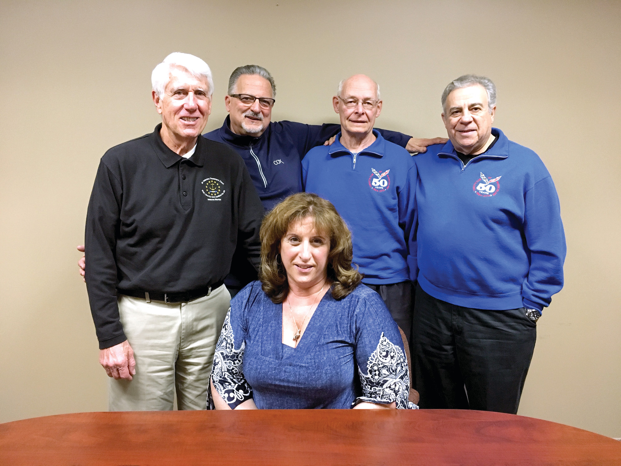 IT'S A FAMILY: Leaders of the Corvette Club met on Friday to chat about the club that celebrates their favorite car. Pictured from left is Membership Director Dennis Langlois, former President Jim Campanini, Board of Directors Member and Historian Richard Nelson, Vice President Tony Montalbano, and President Liliana Dolan.