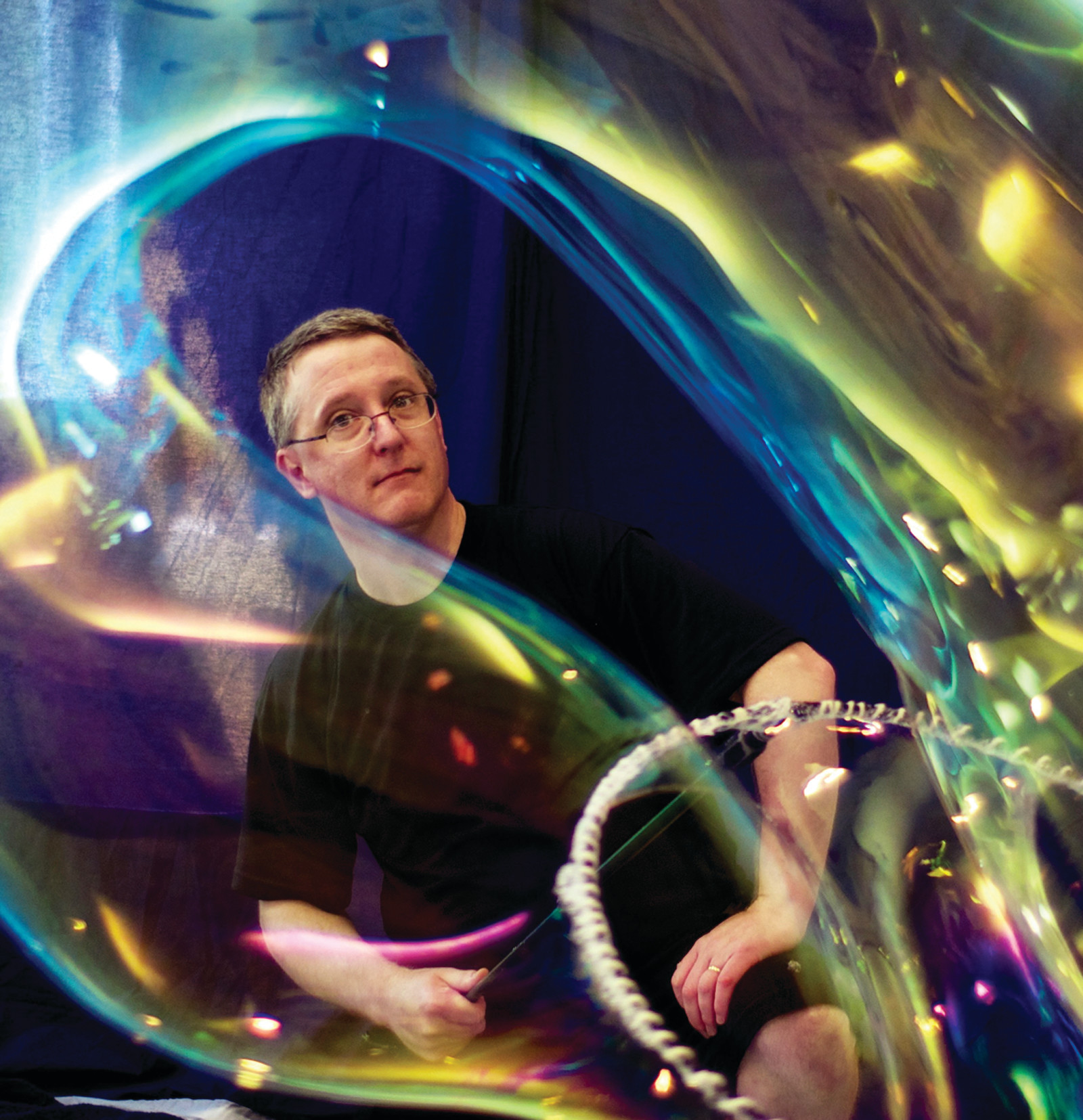 BUBBLE GUY: Keith Michael Johnson is surrounded by one of his bubble creations.