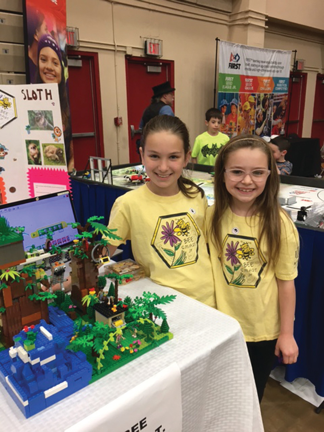 THEIR CREATION: Third graders Madison Medeiros (left) and Aurora Christiansen proudly display their legs robotics project at Sunday's Robot Block Party.