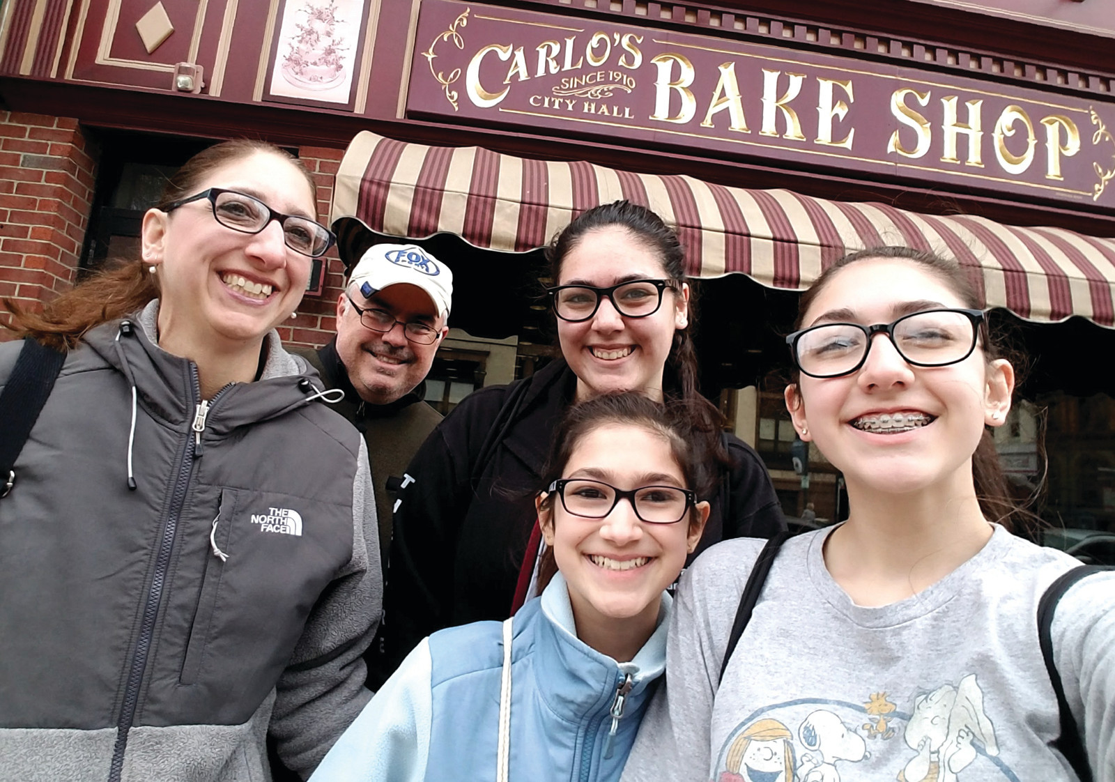 "BIG FANS: A stop at the Hoboken bakery, Carlo's Bake Shop, the original location of television's hit show, ""Cake Boss"" was a great way to start out Day Two of our whirlwind trip. Despite finding a $45 parking ticket on our windshield when we got back to the car, we were still happy we made it a point to stop at the bakery where we all enjoyed some delicious sweet treats. We utilized some of our extra spending money, which had put aside for experiencing some of the local foods."