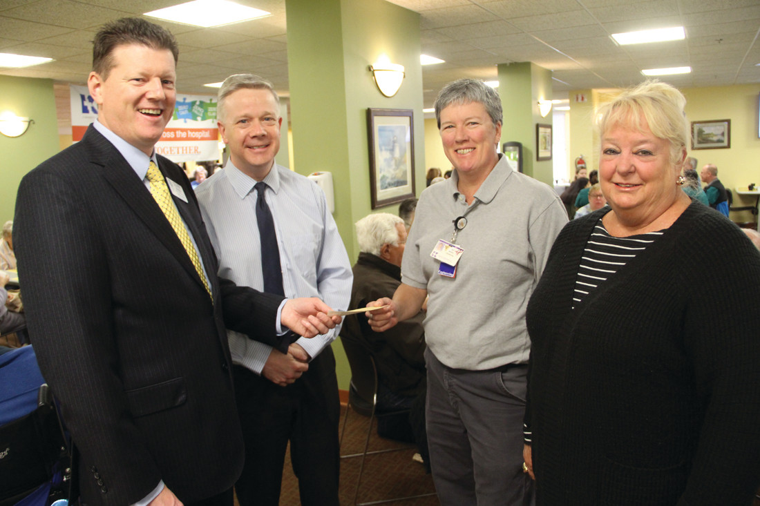 Rotary Club president Oliver Brady makes the presentation as hospital president and COO Dr. Michael Dacey looks on and Sue Barbour and Diane Fitzpatrick of KEEP receive the check.