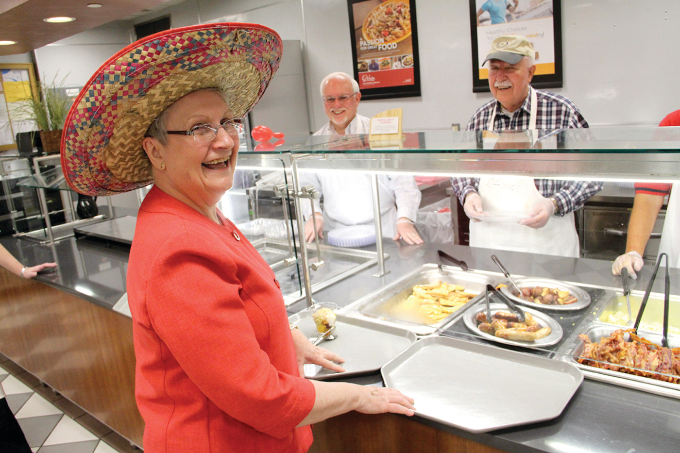 IN THE SPIRIT OF THE DAY: Not only was it the Rotary Club May Breakfast but also Cinco de Mayo, the day Mexican celebrate the May 5, 1862 defeat of France at the Battle of Puelba. Club member Carol Batty donned a sombrero to the amusement of John Smith and Donald Morash who stood by to fill her breakfast order.