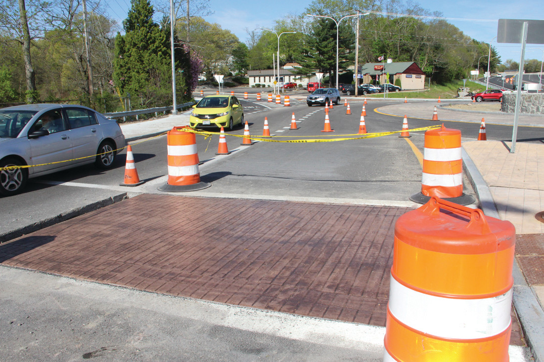 IT'S GOT TO CURE: Traffic has been restricted at crosswalks in order to give concrete the time to cure.