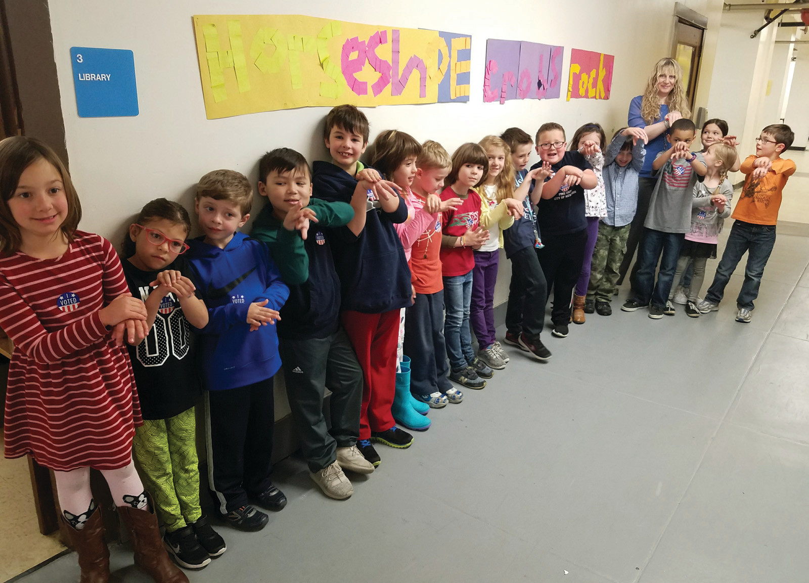 WE VOTED: First-graders lined up outside the school library, finished with their voting, and flashed the special horseshoe crab hand signal that the fourth-graders taught them during their recent lessons.