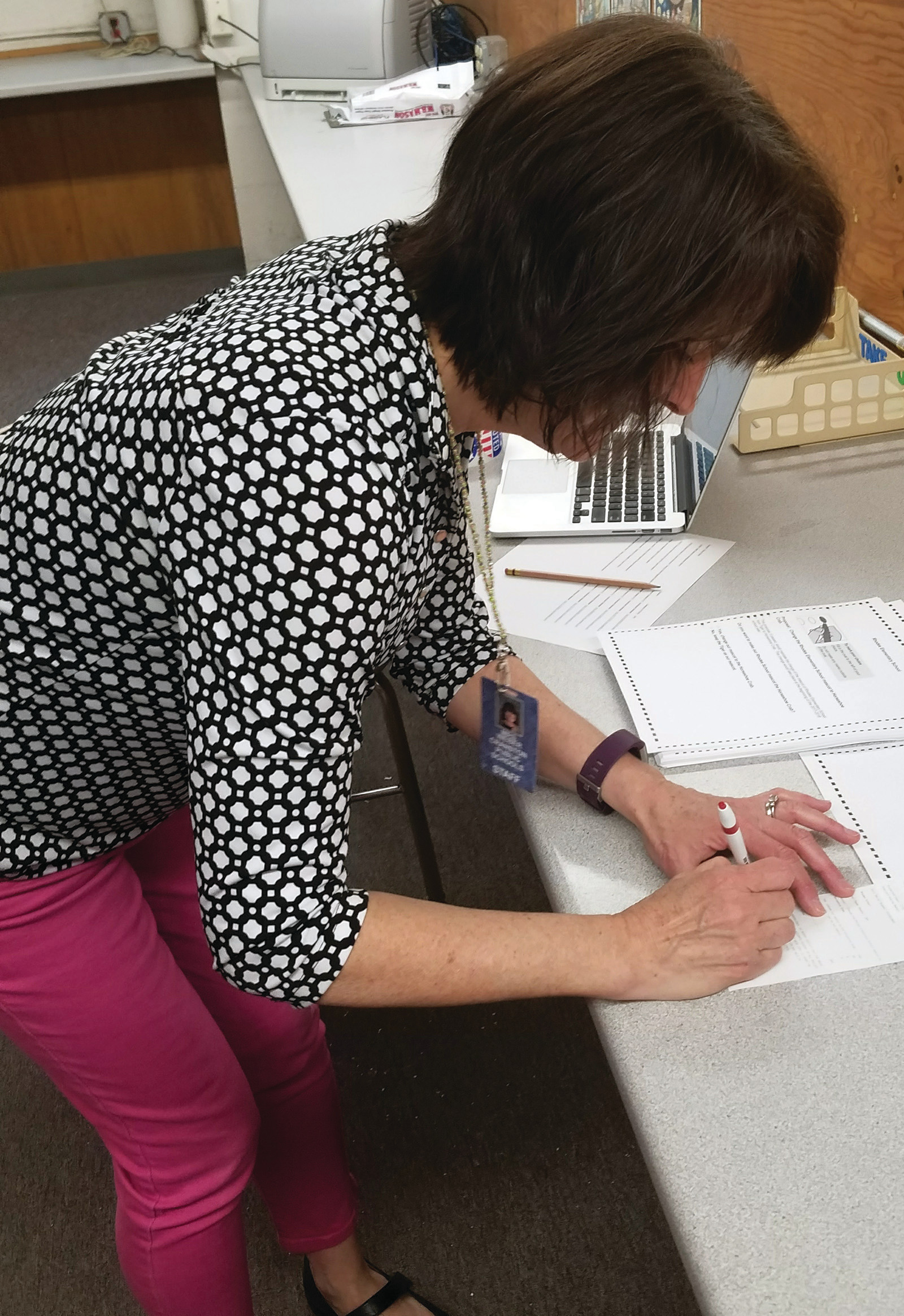 SIGNING OFF: Sue Weber signs off on the final results, just as in a real election.