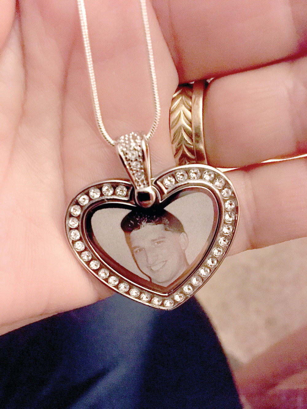 LOCKET OF LOVE: Diane Lang holds a locket with her son Brian's photo inside.