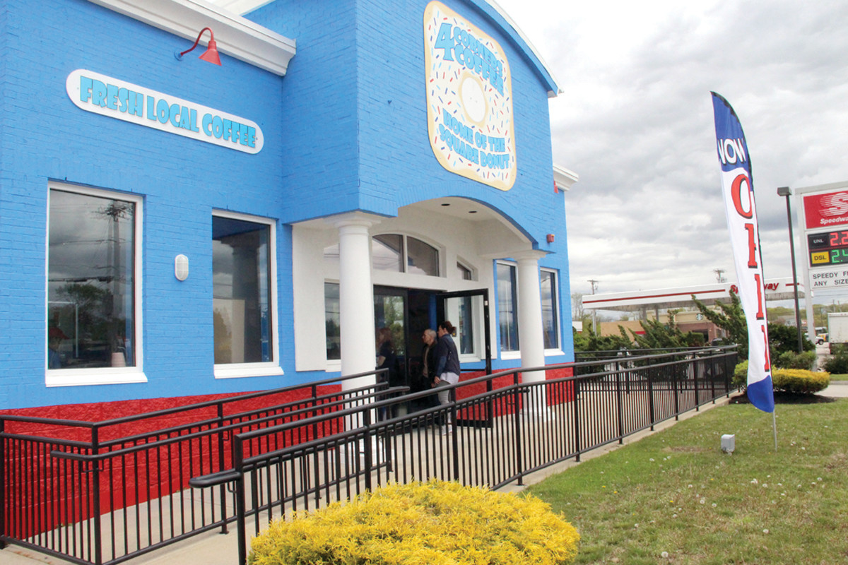THE SQUARE AT THE SQUARE: The 4 Corners Coffee, the bright blue cafe near Hoxsie Four Corners, opened last week to an outpouring of support of customers anxious to sample their specialty doughnuts that are also square.
