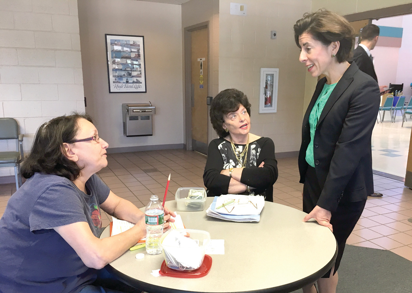 HIGH LOW JACK: Governor Gina Raimondo talks with Joyce Wawryk and Kathy Dermo as they play a card game.