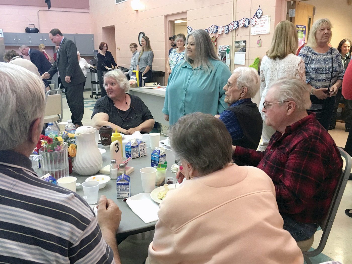 INTRODUCTIONS: Senator Jeanine Calkin meets with seniors during a meet and greet at the Pilgrim Senior Center on Tuesday.
