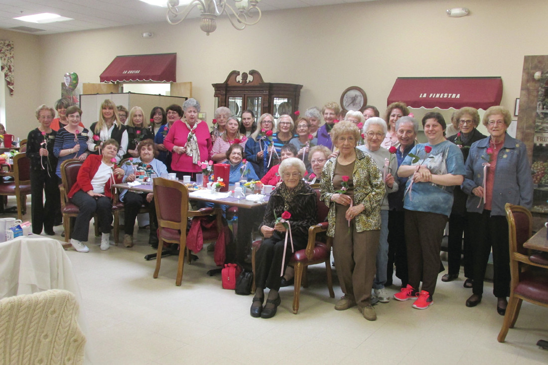 GOLDEN GALS: Each and every lady who was at the JSC's Mother's Day Luncheon Friday received a red rose, courtesy of Linda Giorgio and the Golden Crest Nursing Home in North Providence.