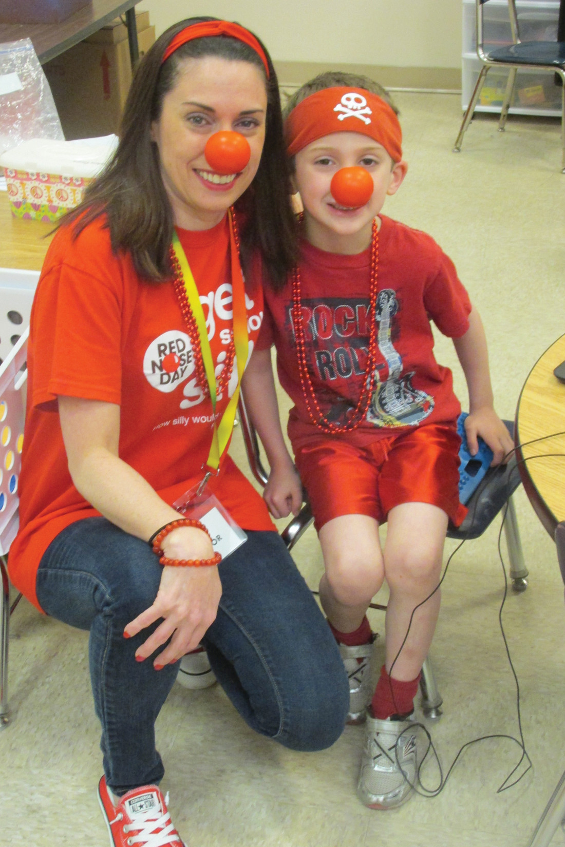 CHAIR'S CORNER: Kristy Pistacchio is joined by her son inside the ECC at the outset of last year's first-ever Red Nose Day in Johnston that will be held next Thursday and is presented nationwide by Walgreen's.