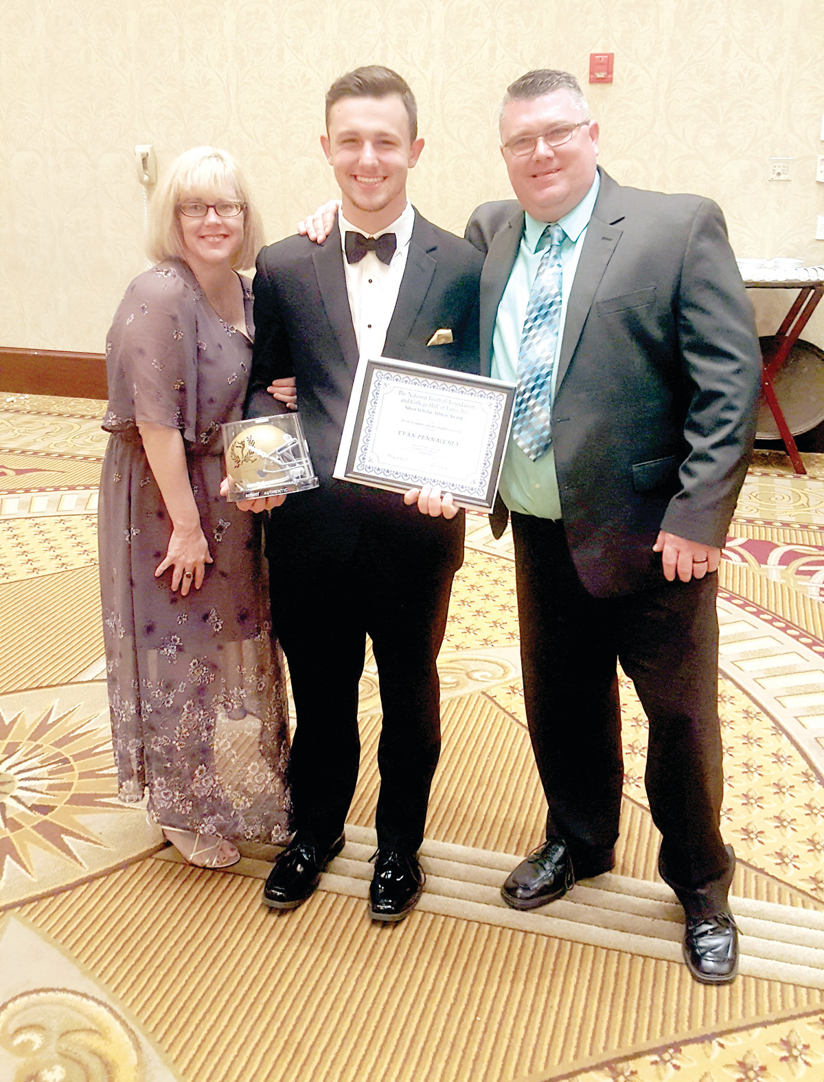 PROUD PARENTS: JHS senior Evan Pennacchia is joined by his mother and father, Shae and Albert Pennacchia, at the recent R.I. Chapter of the National Football Foundation and Hall of Fame Awards Dinner.