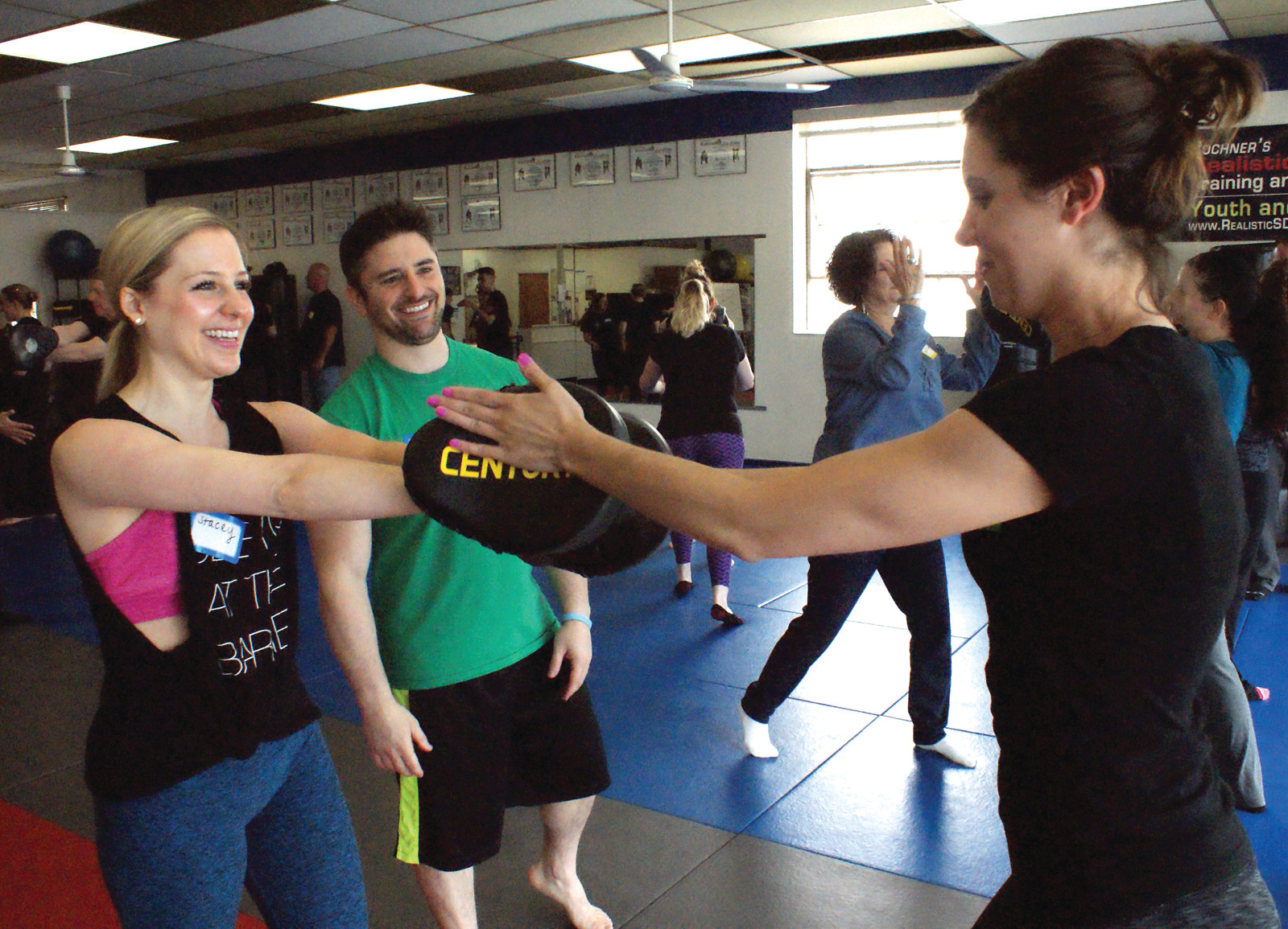 LEARNING TO STRIKE: Sensei Marc Bochner is pictured with (l-r) Stacey Ferranti and Caitlin Reynolds during the free Empower Mom program at Bochner's Realistic Self-Defense on May 21.
