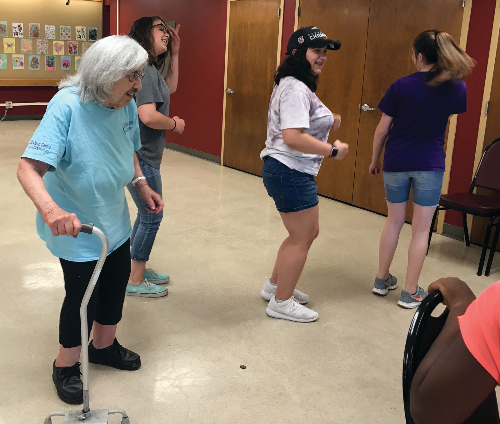 TO THE LEFT, TO THE LEFT: Park View students teach seniors how to do the Cupid Shuffle at their recent trip to the Cranston Senior Center on May 19.