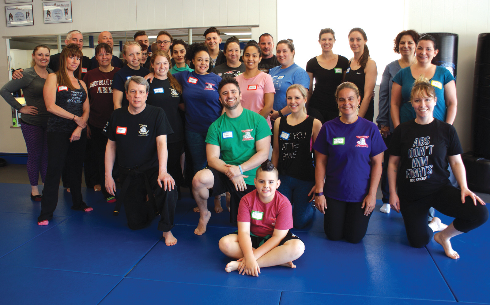 LEARNING SELF-DEFENSE: Pictured is Sensei Marc Bochner, owner of Bochner's Realistic Self-Defense along with participants at the dojo's free Empower Mom program.
