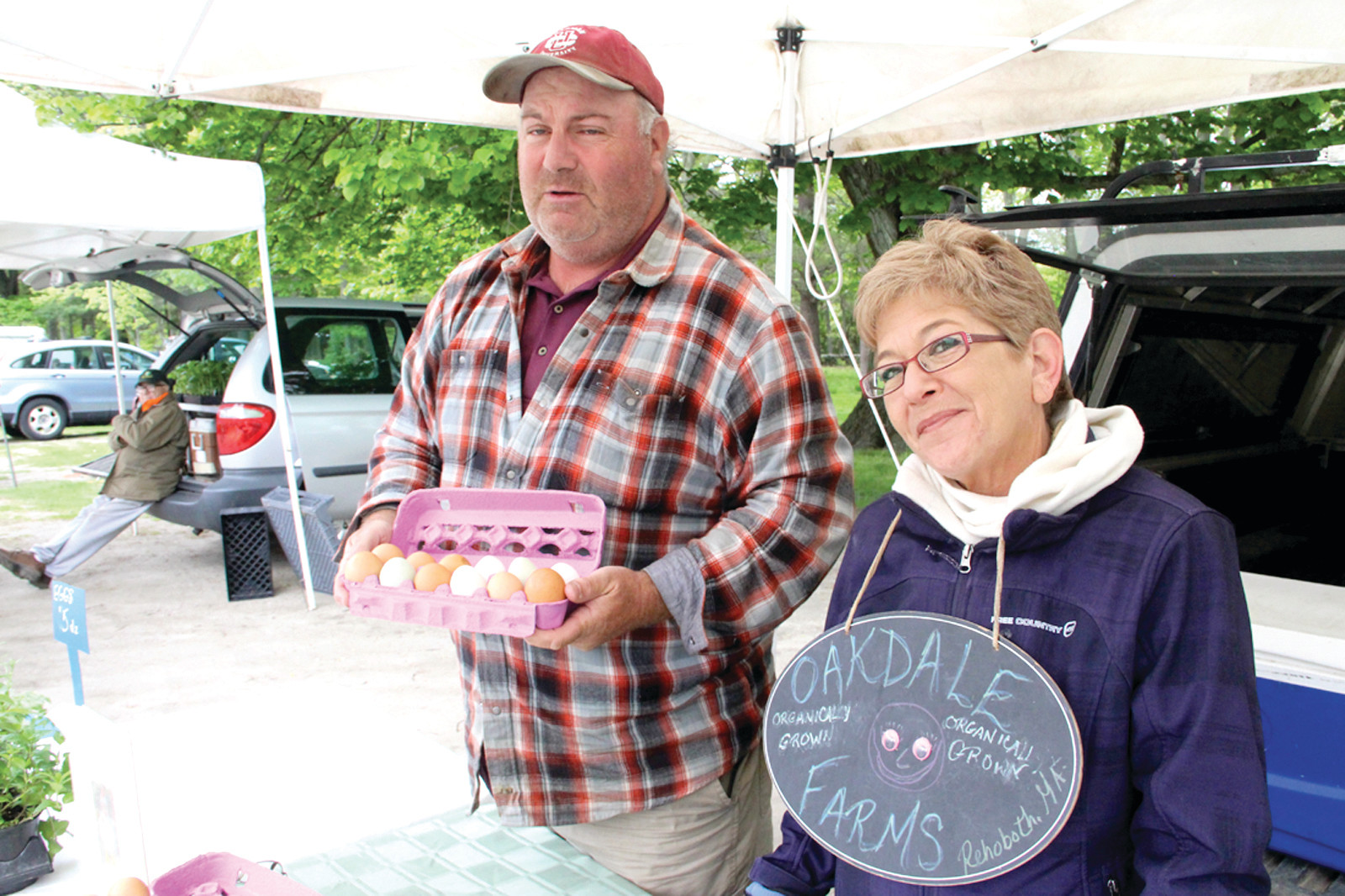BLUE EGGS: Mike Smith from Oakdale Farms in Rehoboth says there's a demand for blue eggs and the farm has them. Smith said there's been a resurgence in locally grown produce. He and Lois Payton are pictured on a recent Friday at the Goddard Park Farmers' Market