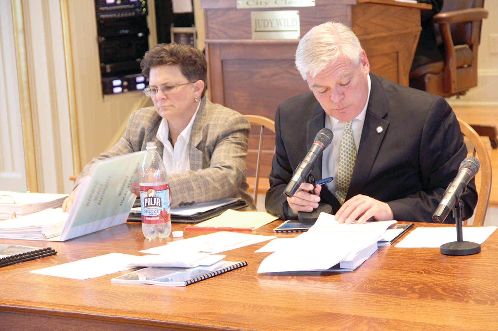 PAGE BY PAGE: Janine Burke-Wells, executive director of the Warwick Sewer Authority, and Mayor Scott Avedisian address the council at Tuesday's budget hearing.