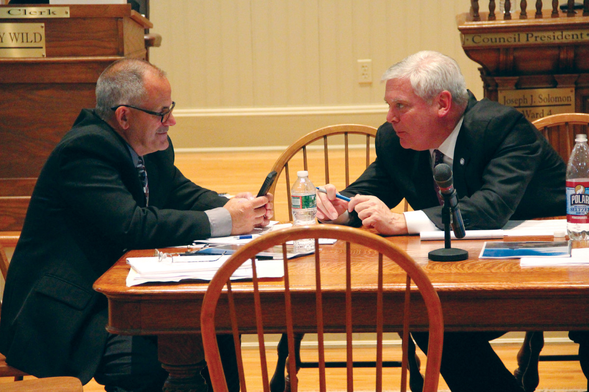 COMPARING NOTES: Chief of staff and public works director David Picozzi and Mayor Scott Avedisian confer during Wednesday's budget hearing.