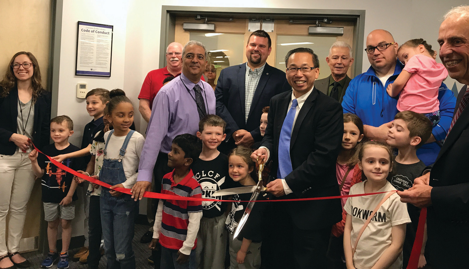 NOW IT'S OFFICIAL: Mayor Allan Fung and his helpers cut the ceremonial ribbon to re-open the Children's Room at Cranston Central Library on Saturday, June 3.