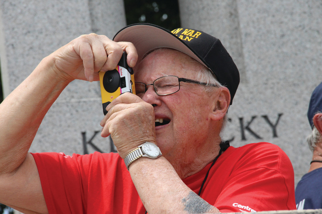 RECORDING THE SIGHTS: Korean War veteran Cornelius Payne records the scene at the WWII Memorial.