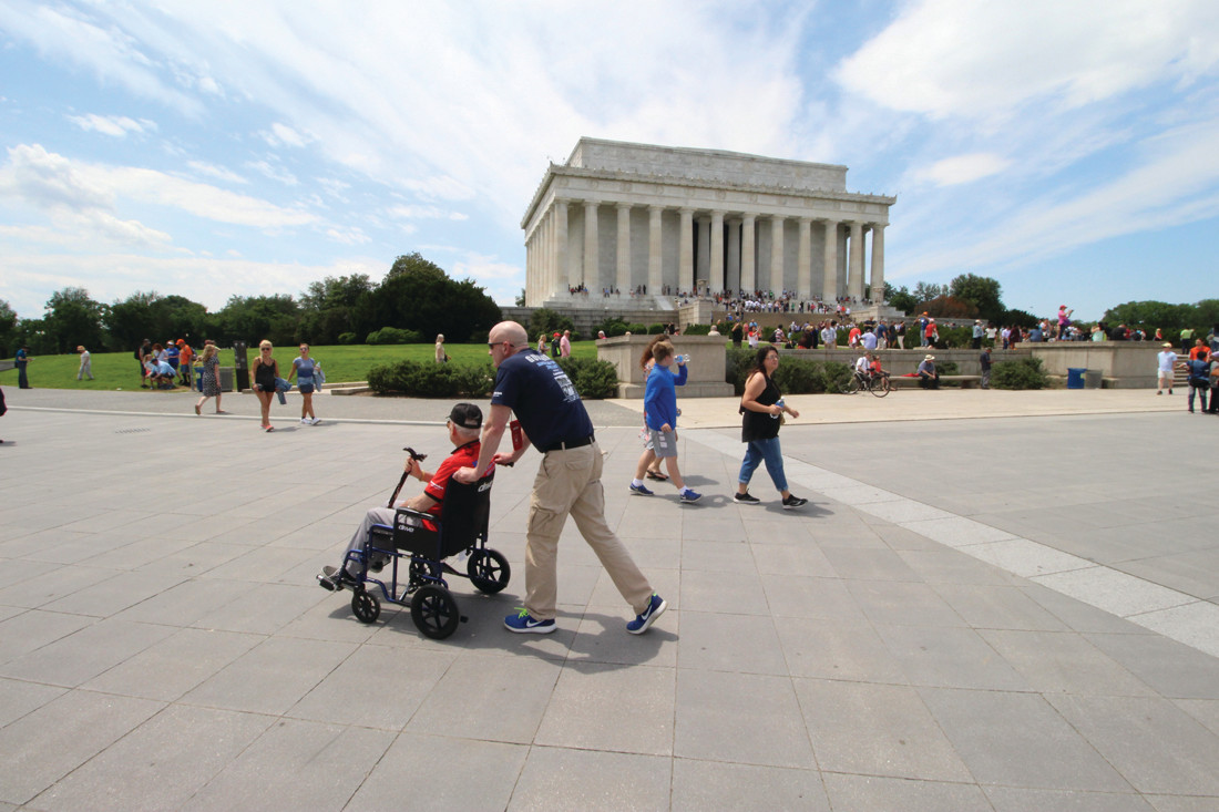 SEEING THE SIGHTS: Guardian Joe Coffey wheels Korean Warw veteran Douglas Gamage past the Lincoln Memorial.