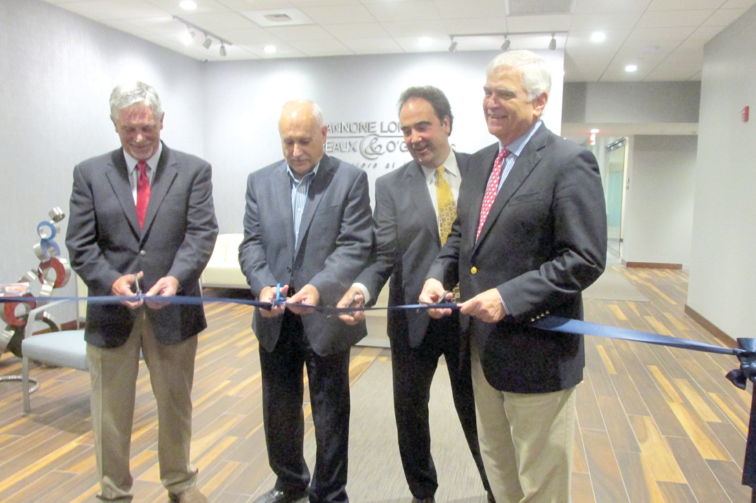 KEY CLUB: Mayor Joseph Polisena enjoys a lighter moment with William F. O'Gara during last week's ribbon cutting ceremony at the law firm's new headquarters in Johnston as Gary R. Pannone (left) looks on.