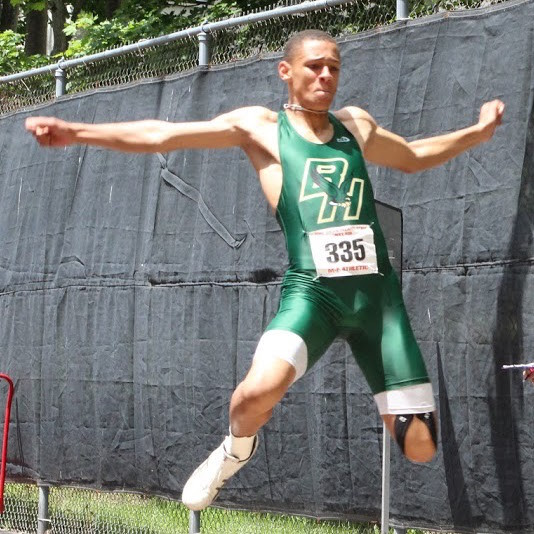 GAUGING THE JUMP: Hendricken's Joseph Rivera Santos was in action during the boys' long jump event at the outdoor state meet last weekend.