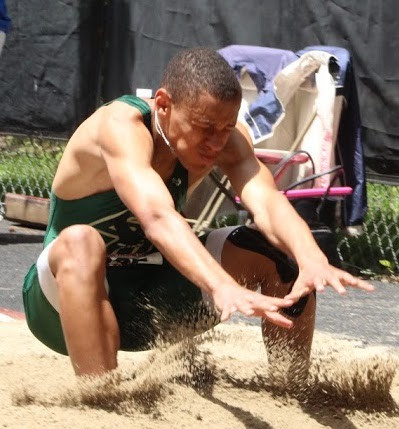 STICKING THE LANDING: Rivera Santos, seen here finishing his long jump, would go on to grab silver in the 110-meter hurdles and seventh in the 300-meter hurdles.