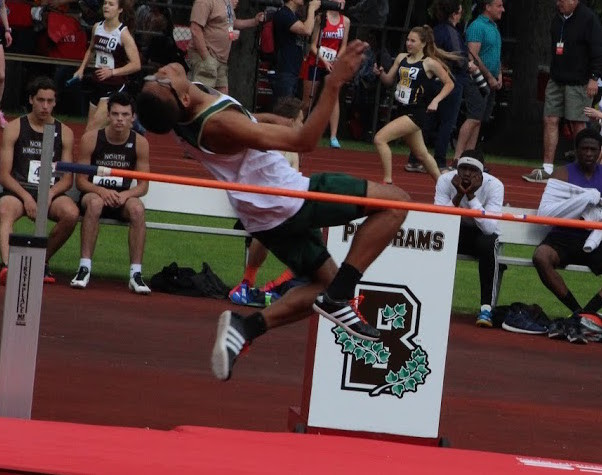 UP AND OVER: Hendricken's Duwuan Edwards took fourth in the high jump.