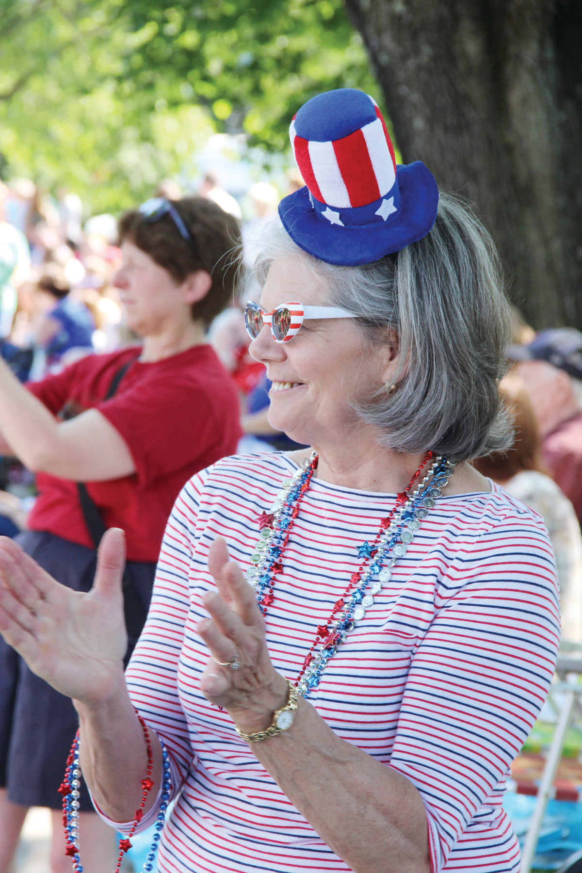 WEARING HER TOP HAT: Kathy Crowley was decked out for a parade with her patriotic hat and beads.