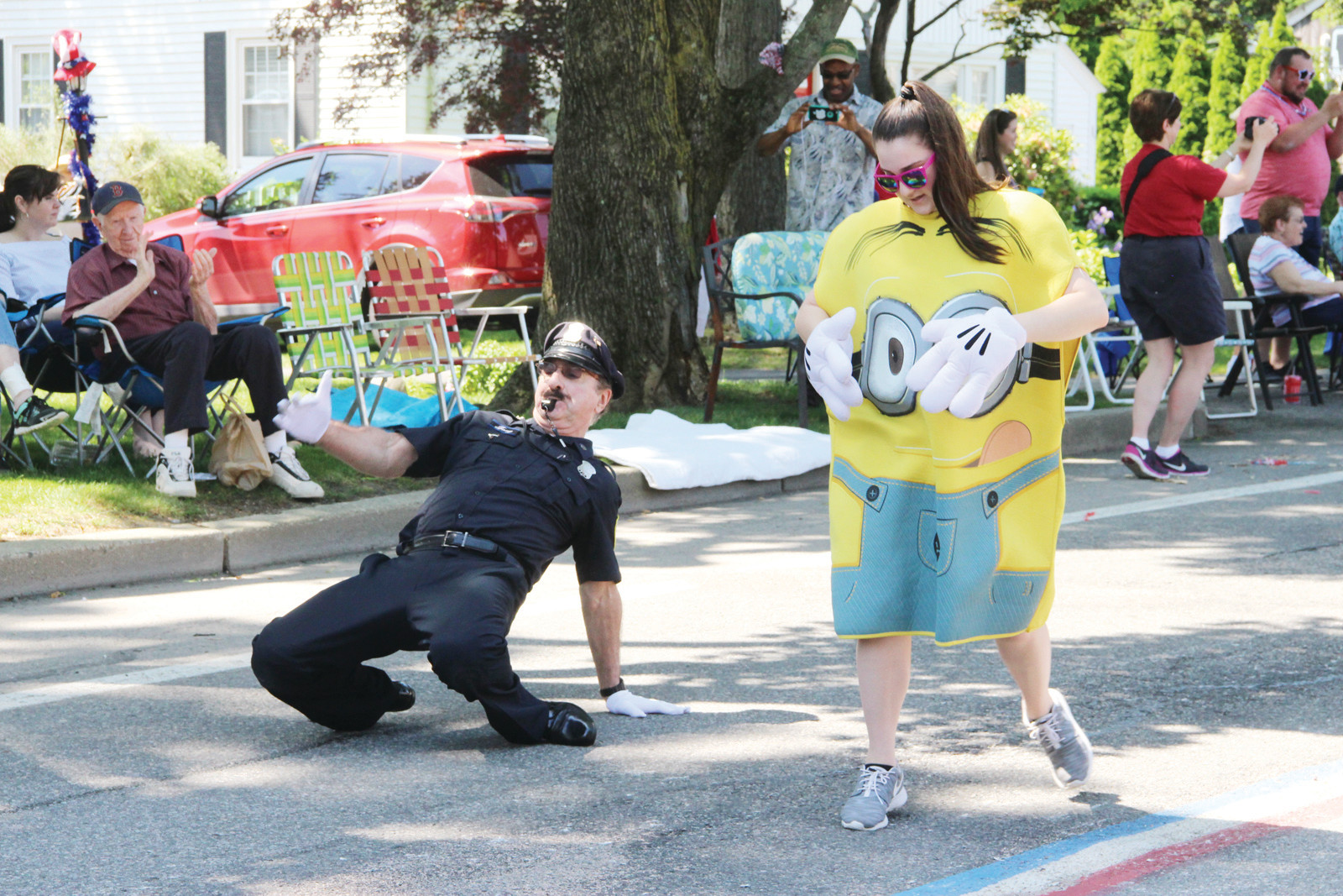 "DANCING IN THE STREET: Providence's famous ""Dancing Cop,"" Tony Lepore, put on a lively show, even getting a few spectators to join him"