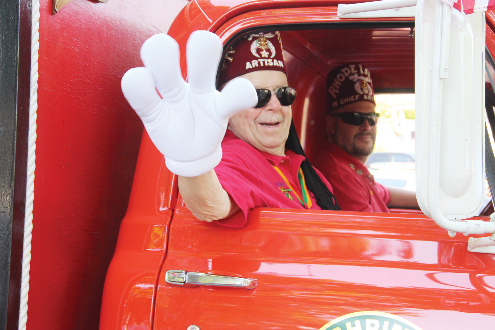FINGER WAVE: A Shriner waves to the crowd.