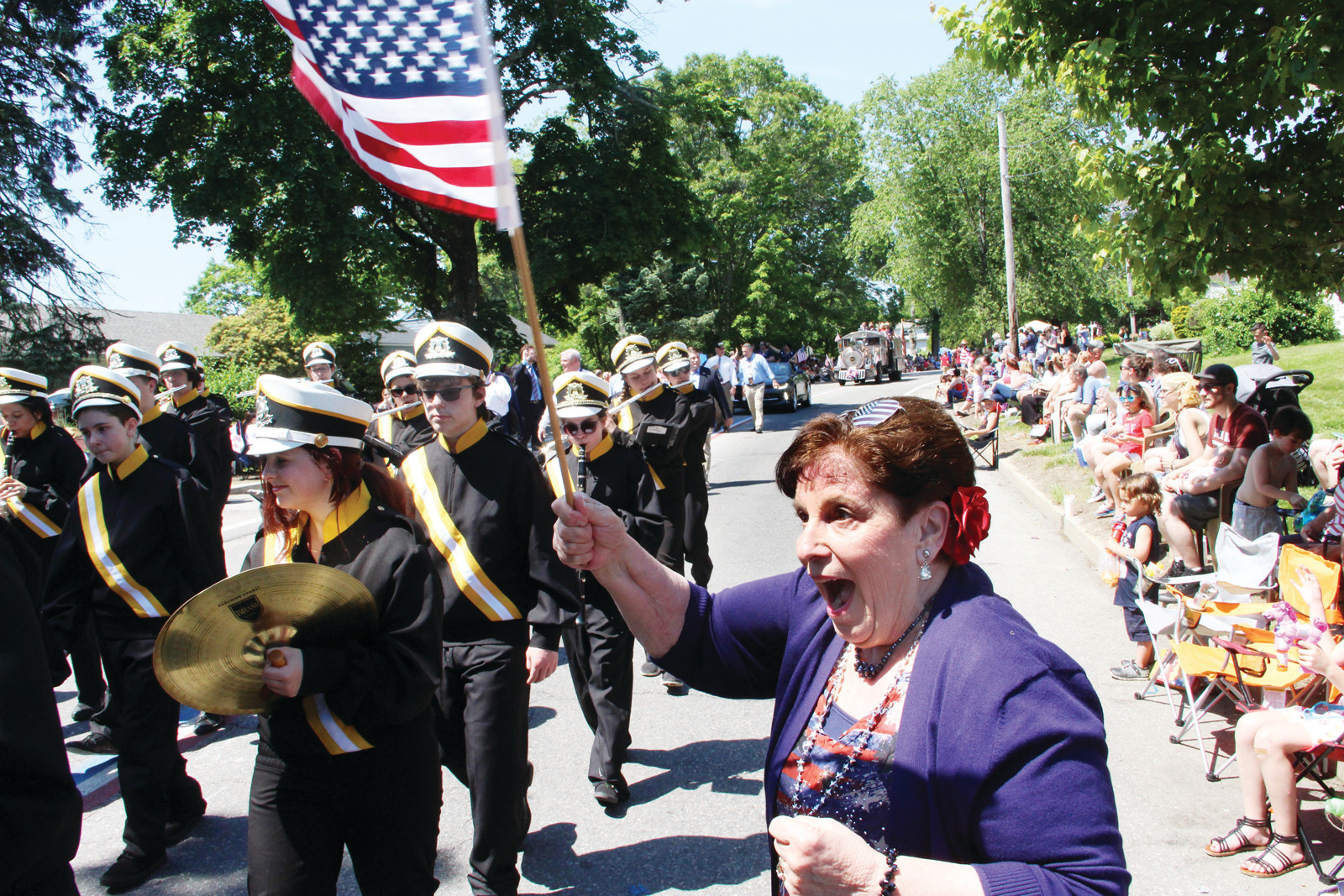 CHEERING THEM ON: Flag waving Marcia Beagan cheers the Pilgrim marching band. She did the same for Toll Gate, Cranston East and Cranston West.