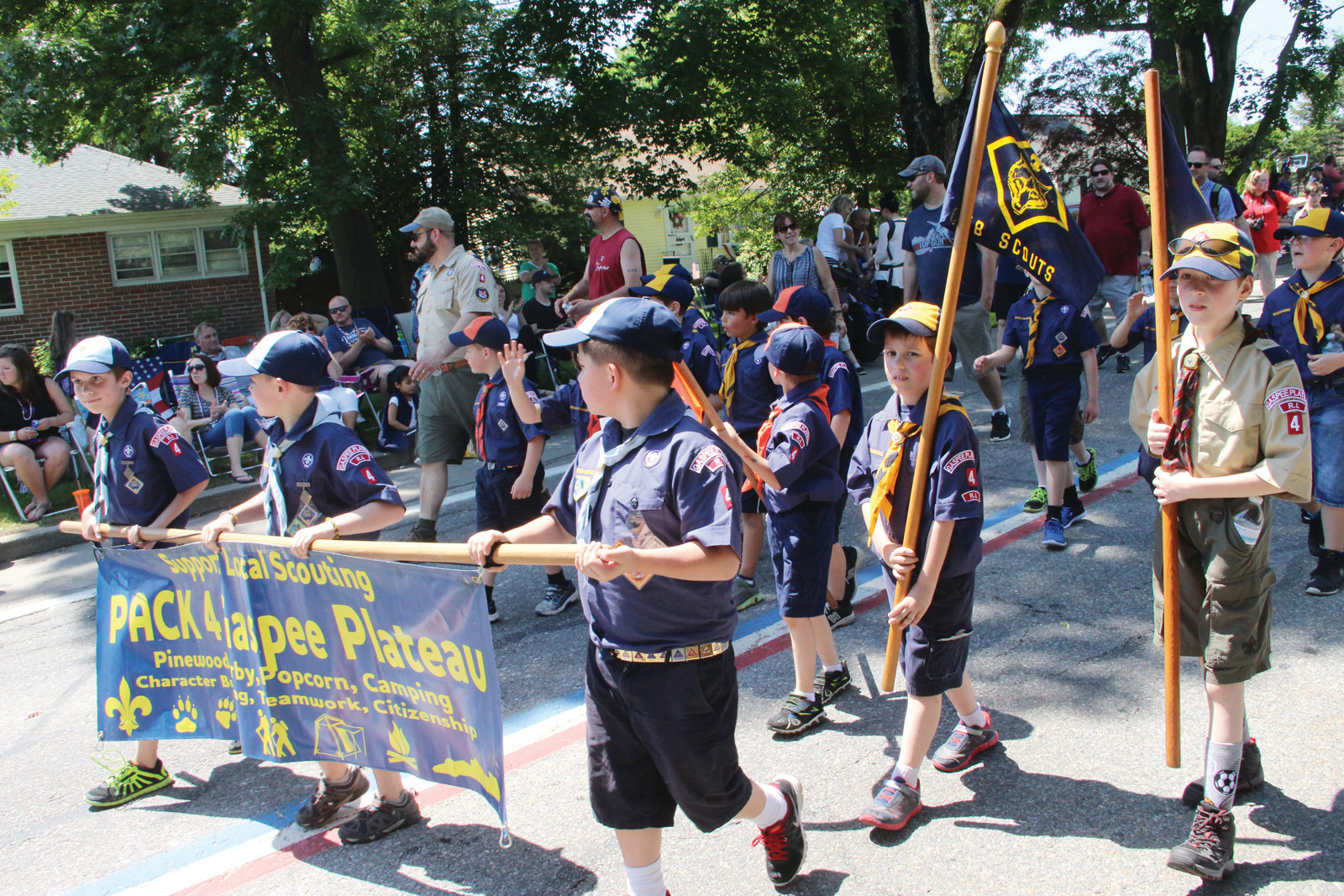SCOUTS ON THE MARCH: Pack 4 Gaspee Plateau got lots of cheers as they marched.