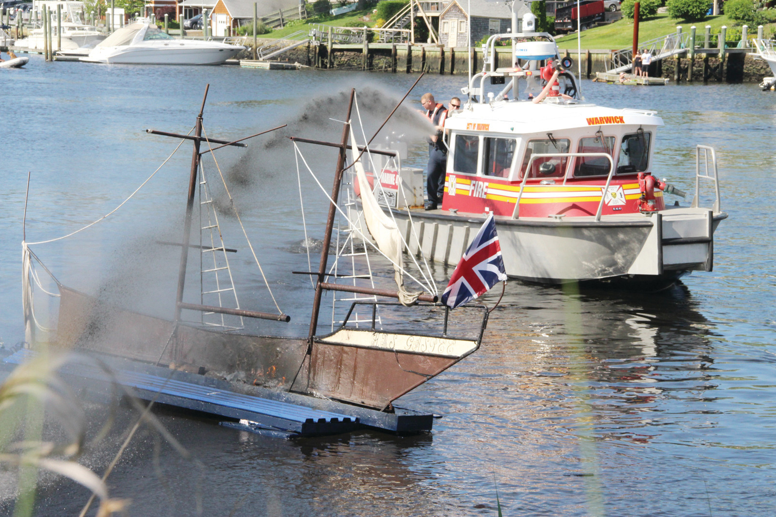 END OF ANOTHER GASPEE DAYS: A Warwick Fire Department boat douses the Gaspee as the 52nd annual celebration comes to a close on Sunday afternoon.