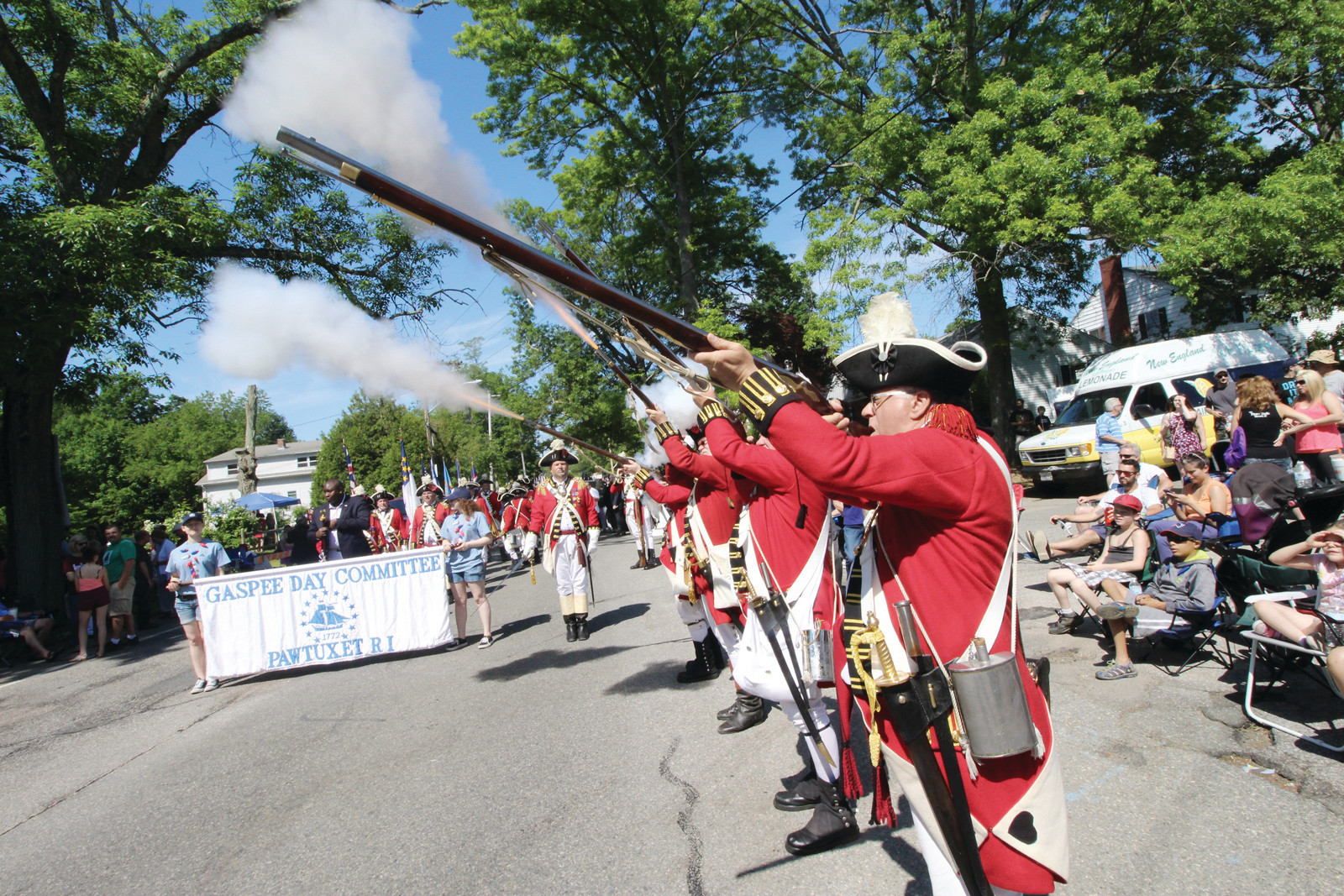 HISTORY AND COMMUNITY: Members of the Pawtuxet Rangers fire off a volley during the 2017 Gaspee Days Parade as participants and people along the parade route look on. This year's Gaspee Days festivities kick off Saturday with the Proclamation Ceremony and Walking Tour of Historic Pawtuxet Village.
