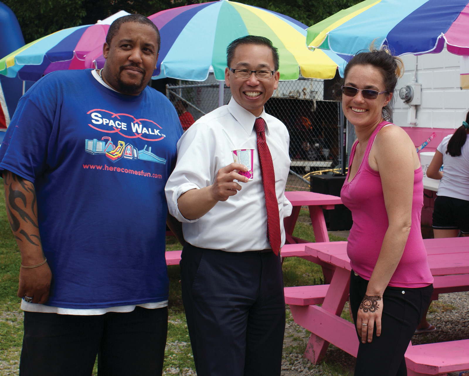 TIME FOR SLUSH: Cranston Mayor Allan Fung stopped by at the free Family Fun Day at the New England Slush Company and enjoyed his Pina Colada-Flavored slush. Pictured with the Mayor are Co-owners Derek Nelson and Crystal Larkin.