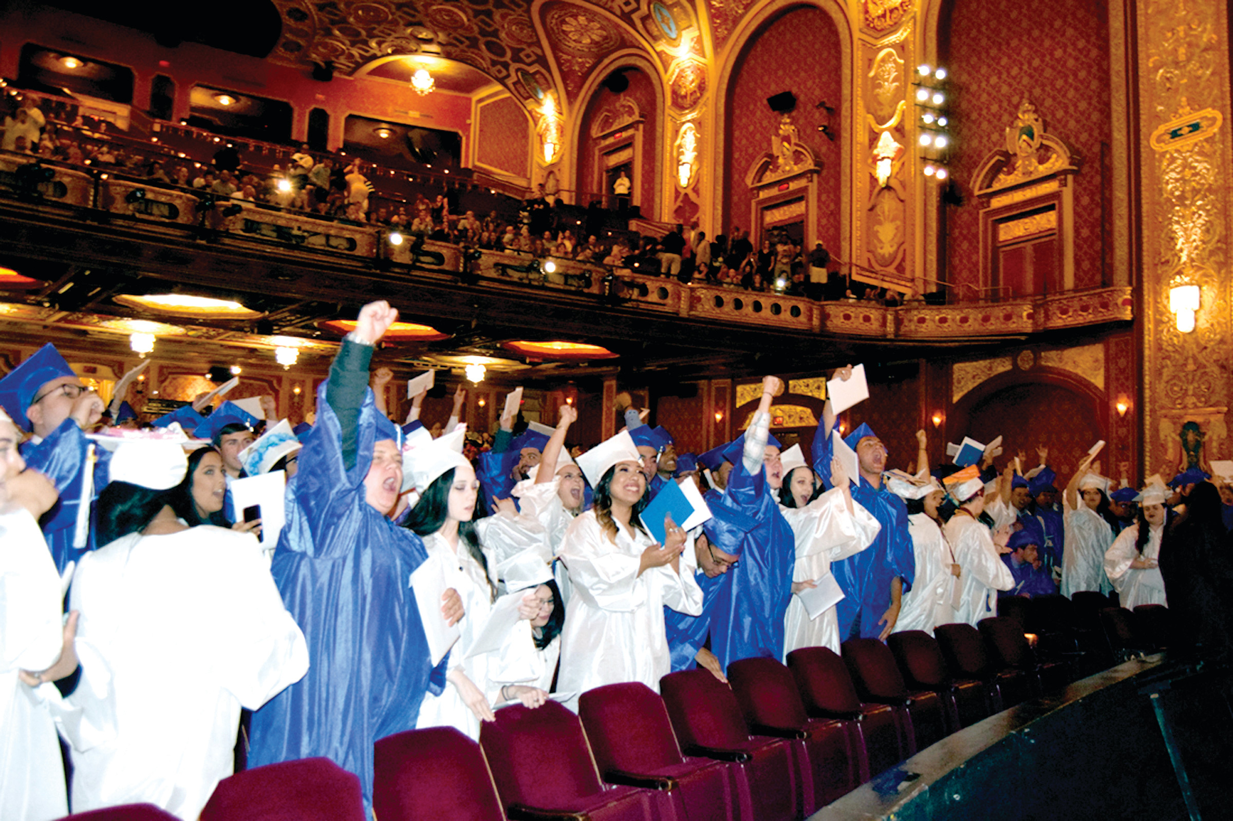 PANTHERS ROAR: Johnston seniors celebrate after receiving their diplomas at graduation on Friday at the Providence Performing Arts Center.