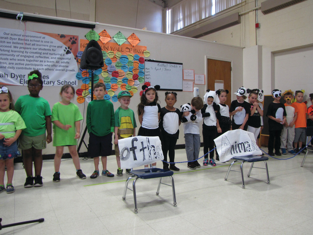OH MY: Students dressed as lions, tigers and more as they recited animal facts to a packed house at the school last Friday.