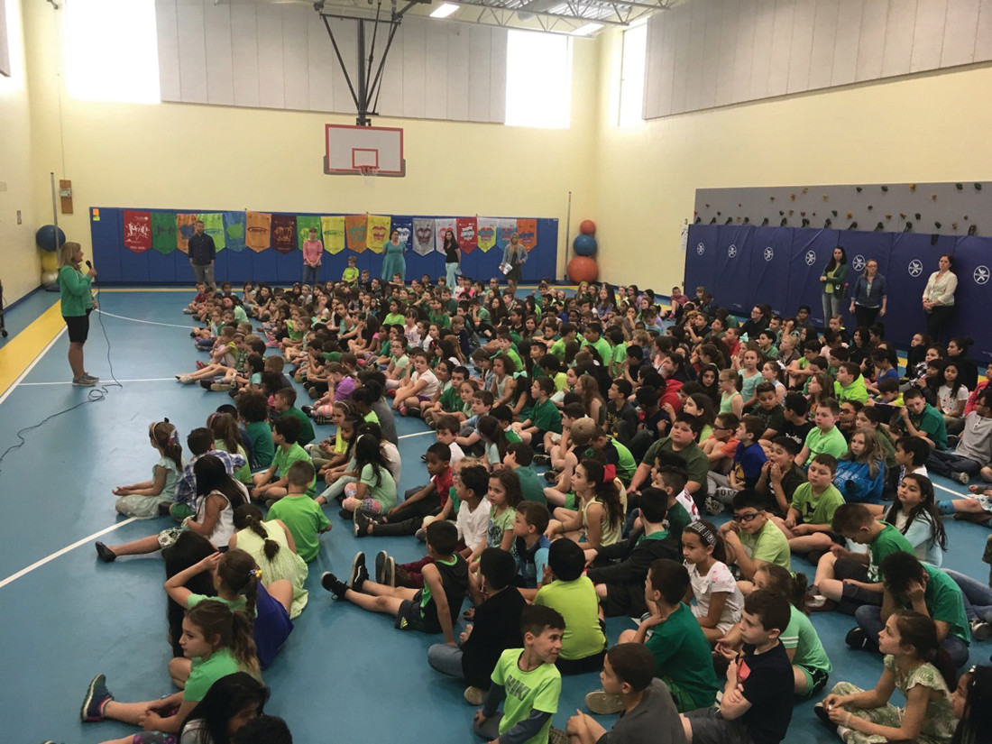 SEA OF GREEN: Winsor students gathered in the school's gymnasium to listen to presentations about mental illness and being kind to others.