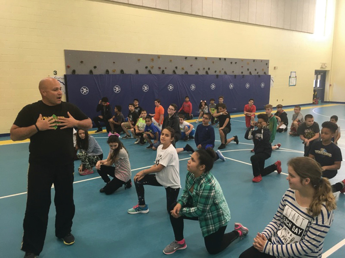 GET MOVING: Mario Mennella of Premier Martial Arts had students jumping, kicking and chopping with a martial arts demonstration.